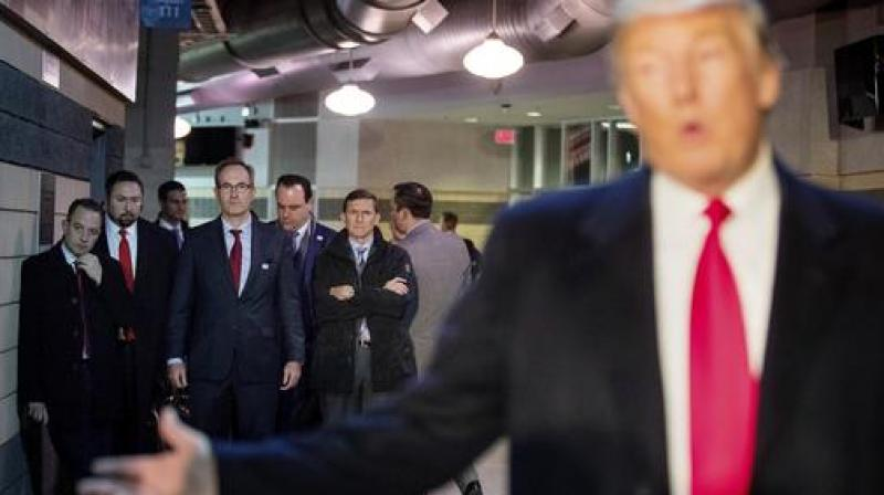 Trump's Chief of Staff Reince Priebus, left; Jason Miller, a senior adviser, second from left; Boris Epshteyn, a spokesman for Trump, fourth from left, and Michael Flynn, Trump's nominee for National Security adviser, fifth from left, listen as Trump speaks. (Photo: AP)