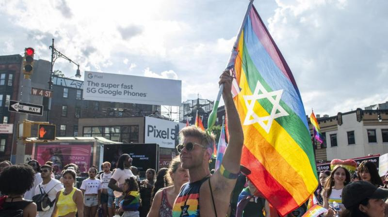 People gather during the Queer Liberation March in the West Village on Sunday, June 27, 2021, in New York. (Photo: AP)