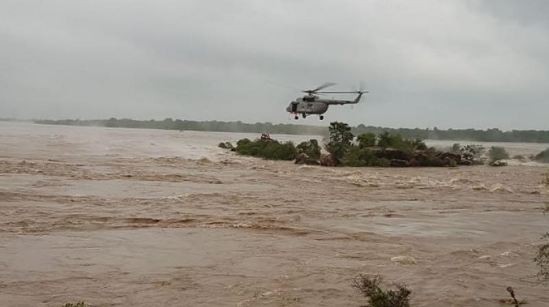 The IAF personnel rescued 14 people stranded in Lalitpur and Jhansi districts due to heavy rainfall, drawing praise from Uttar Pradesh Chief Minister Yogi Adityanath. (Photo: Twitter   @IAF_MCC)