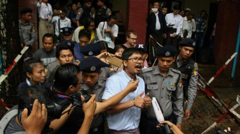 Detained journalist Wa Lone speaks to the media after exiting the court on July 9, 2018. (Photo: AFP)
