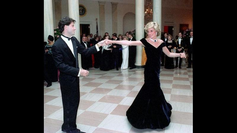 """Diana wore the dress in 1985 at a White House state dinner, where she danced with the """"Grease"""" actor. (Photo: Instagram)"""
