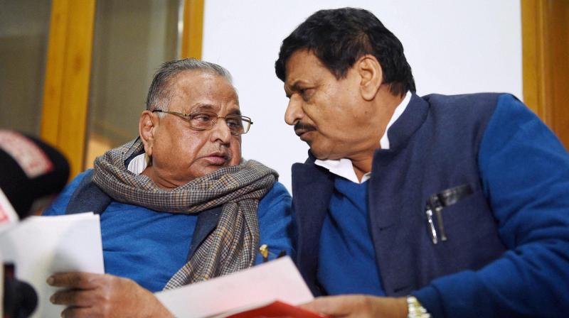 Samajwadi Party supremo Mulayam Singh Yadav with Shivpal Yadav. (Photo: PTI)