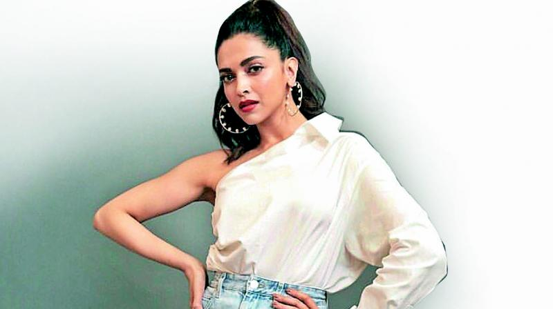 Deepika Padukone in a button down white shirt with a cold shoulder look (Photo: Pics from Instagram)