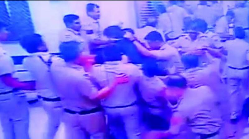 Policemen and lawyers beating each other at Tis Hazari court on Saturday.