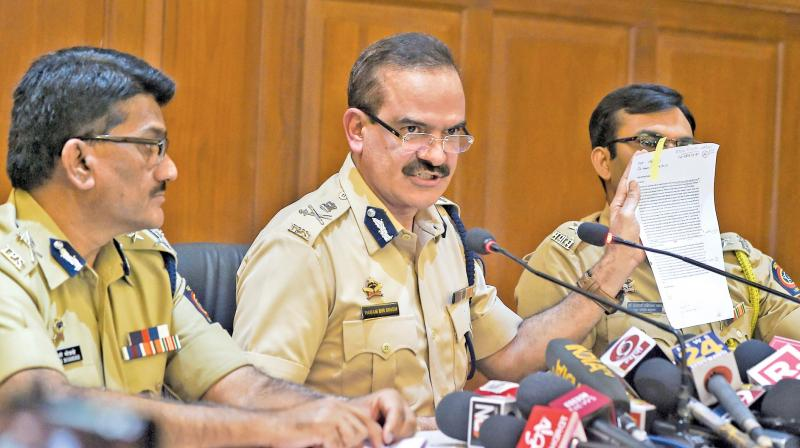File picture of the press briefing conducted by the Mumbai police officials.
