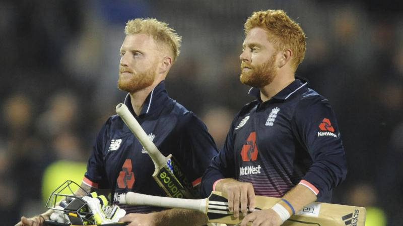 England's Johnny Bairstow, right, and England's Ben Stokes leave the pitch after England beat the West Indies by seven wickets. (Photo: AP)