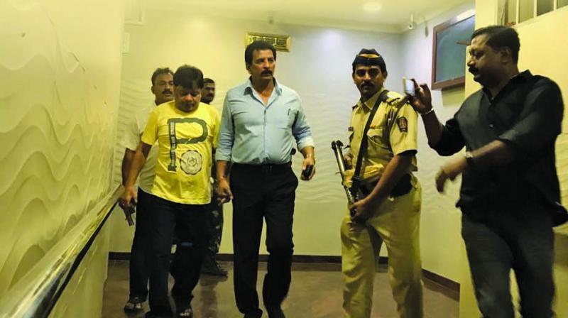 Iqbal Kaskar in police custody after his arrest on Monday.