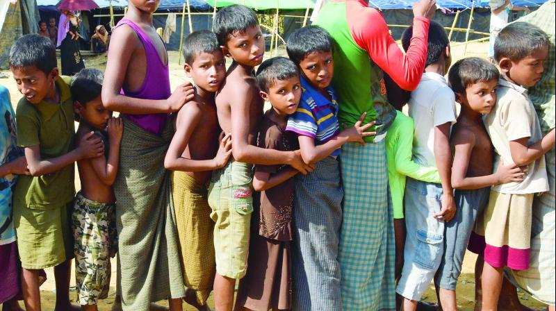 Children lining up for relief supplies at the Kutupalong refugee camp for Rohingyas who have fled to Bangladesh to escape violence in Myanmar. (Photo: AFP)
