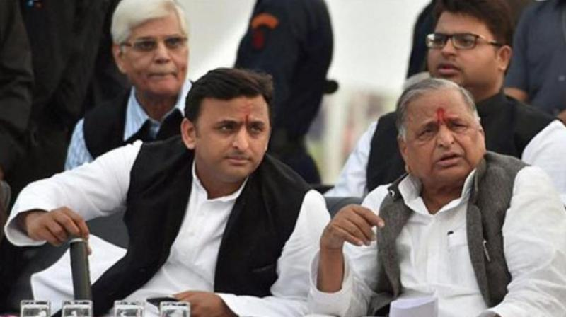 Samajwadi party chief Akhilesh Yadav and Mulayam Singh Yadav (Photo: PTI/File)
