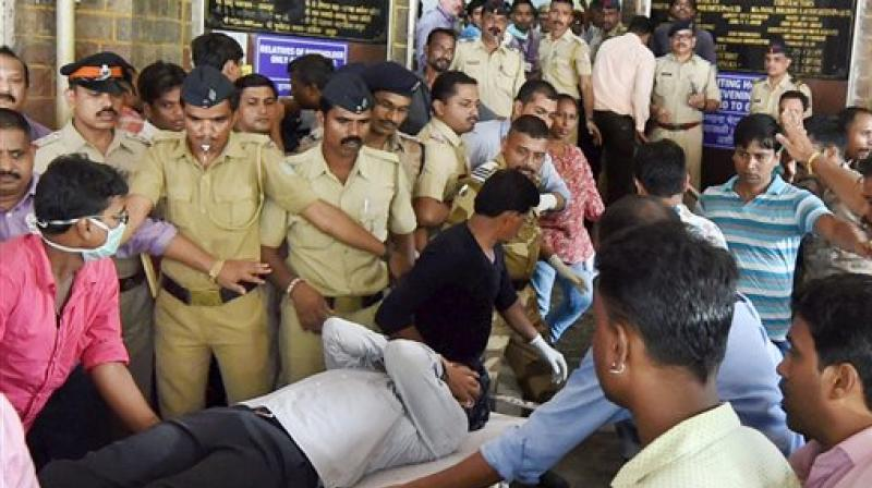 An injured being shifted to a hospital in Mumbai on Friday after a stampede at Elphinstone railway station. (Photo: PTI)