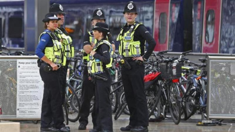 Police provide security at Paddington mainline train station in London, after a terrorist incident was declared at nearby Parsons Green subway station Friday. (Photo: AP)