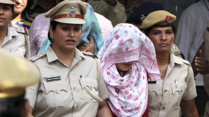 Honeypreet Insan (head covered with scarf) leaves after being produced in a court in Panchkula. (Photo: AP)