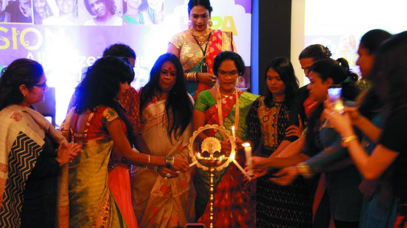 Gauri Sawant with two other participants lighting the lamp at the transgender convention which was held on September 22.