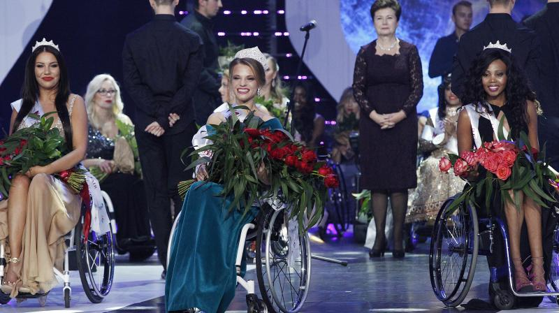 Aleksandra Chichikova (center), from Belarus, with second placed Lebohang Monyatsi, right, from South Africa and third placed Adrianna Zawadzinska, left, from Poland during the Miss Wheelchair World 2017 beauty pageant final in Warsaw, in Warsaw, Poland. (Photo; AP)