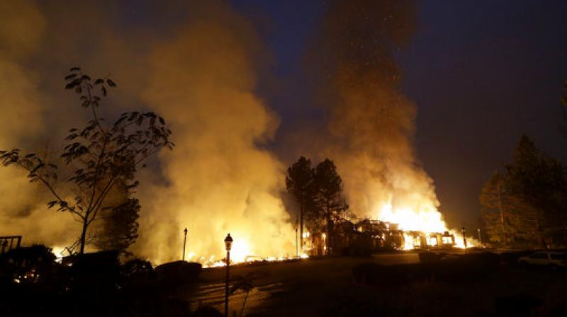 Residents who gathered at emergency shelters and grocery stores said they were shocked by the speed and ferocity of the flames. (Photo: AP)