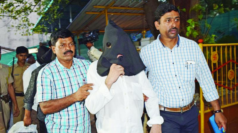 File picture of Iqbal Kaskar being brought to a police inquiry.