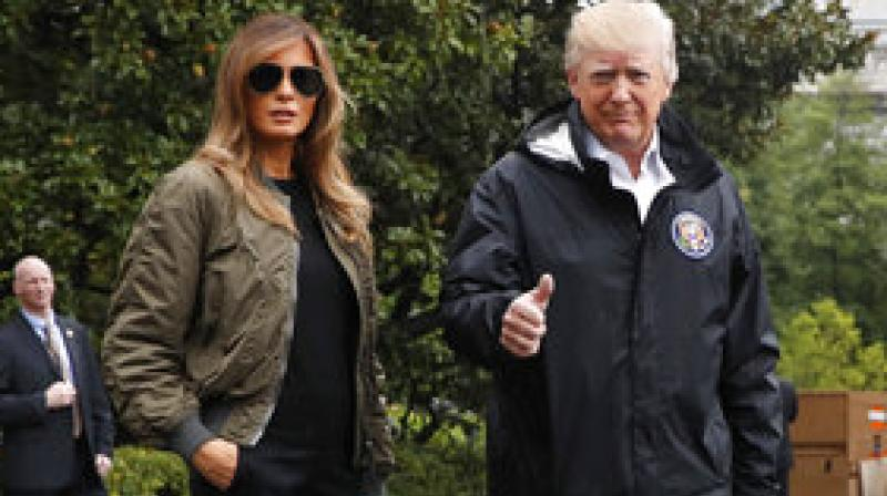 President Donald Trump, accompanied by first lady Melania Trump, gives a thumbs-up as they walk to Marine One on the South Lawn of the White House in Washington, Tuesday, Aug. 29, 2017, for a short trip to Andrews Air Force Base, Md., then onto Texas to survey the response to Hurricane Harvey. (Photo: AP)