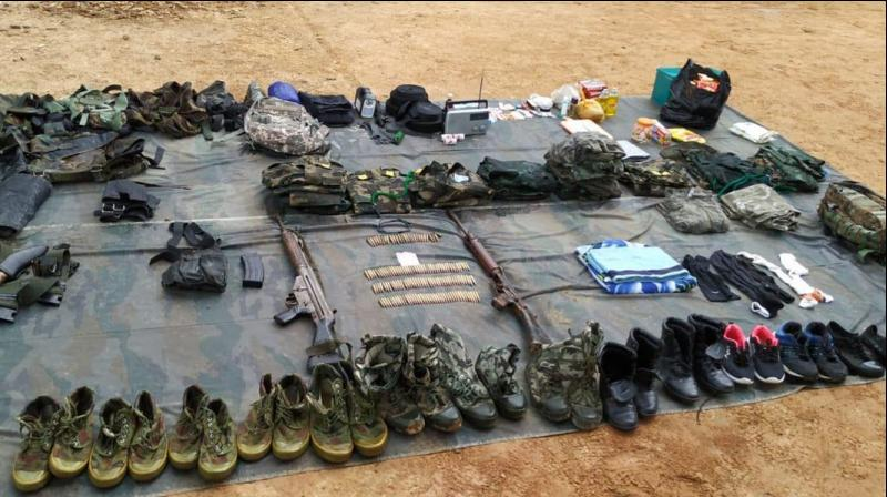 The weapons found by the raiding team included an American made M16 assault rifle with 125 rounds, one self-loading rifle with 26 rounds and some AK series assault rifles, apart from other 'warlike stores'. (Photo: Twitter | @easterncomd)
