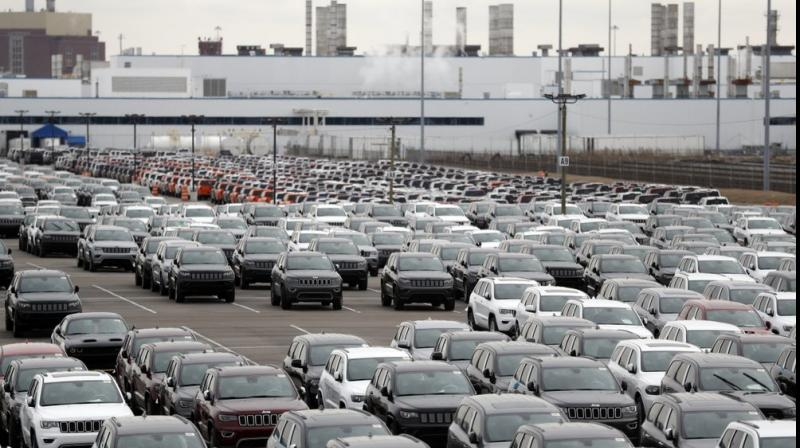 FILE - Jeep vehicles are parked outside the Jefferson North Assembly Plant in Detroit. Fiat Chrysler is backing off a planned May 4 restart at its North American factories because some U.S. states still will have stay-home orders in place. The move likely means that factories of all three Detroit automakers will be idled for at least another two weeks as they negotiate reopening terms with the United Auto Workers union. (AP Photo)