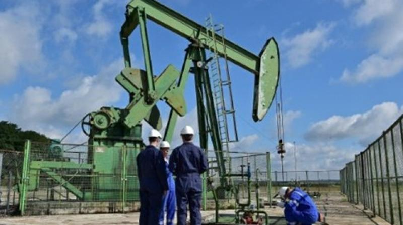 Oil prices rise on early signs of slowing U.S. glut build. AFP Photo()