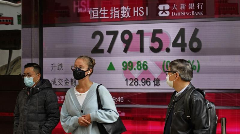 Asian markets rallied again and oil prices built on the previous day's surge. (AFP Photo)
