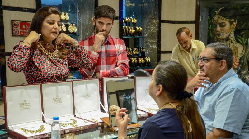 Jewellery demand and gold investment demand also declined in the first quarter. (AFP Photo)