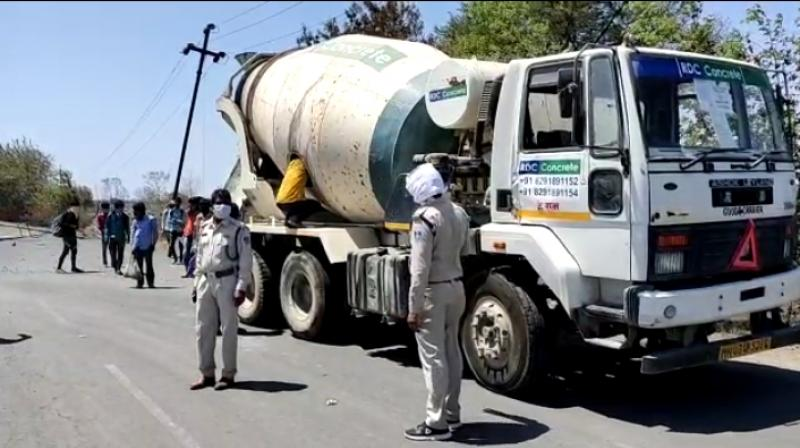 14 labourers 'rescued' from concrete mixture truck. (DC Photo)