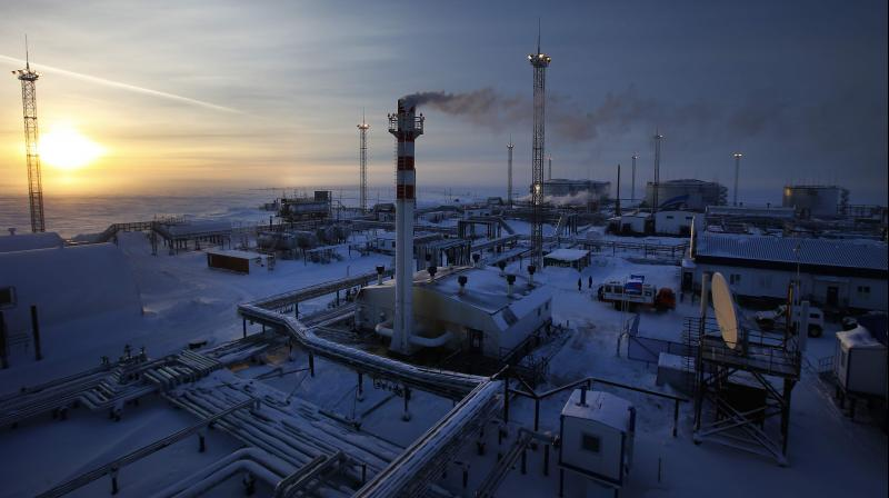 Storage facilities of Novoprtovskoye oil and gas condensates oilfield of Russian gas and oil giant Gazprom at Cape Kamenny in the Gulf of Ob shore line in the south-east of a peninsular in the Yamalo-Nenets Autonomous District. (AFP Photo)