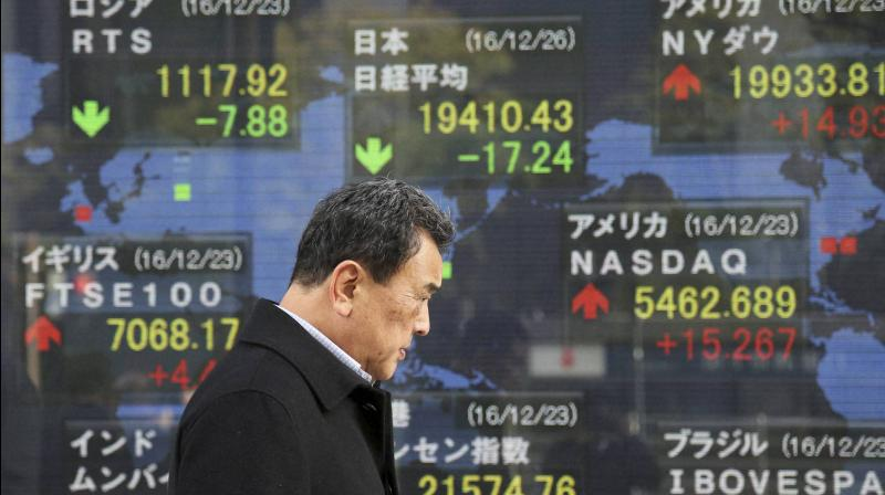 Asian stocks slip as U.S.-China tensions flare. (AFP Photo)