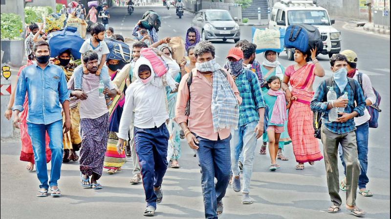 Hundreds of migrant labourers working in the Hyderabad city started marching to Srikakulam district in AP from Secunderabad immediately after extension of national lockdown. They were stopped at the check post between Habsiguda and Uppal and sent to shelter homes. (Deccan Chronicle Photo)