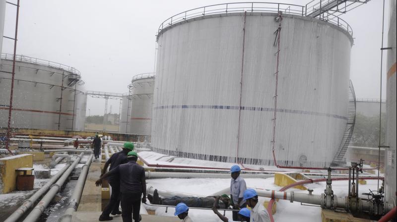Oil marketing companies shares drop 13%. (PTI Photo)