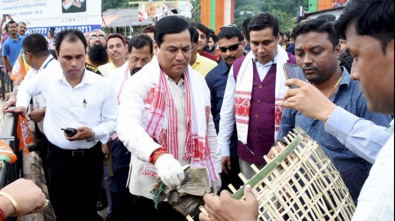 Assam chief minister Sarbananda Sonowal stressed the need of proper implementation of all the government schemes so that benefits percolate down to all the genuine beneficiaries, (PTI Photo)