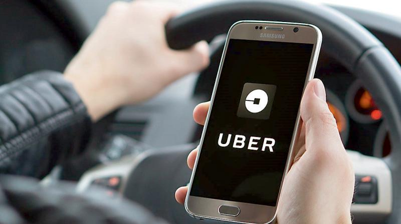 Uber on Wednesday said it would lay off 3,700 full-time employees, or roughly 17 percent of its head count. (AFP Photo)