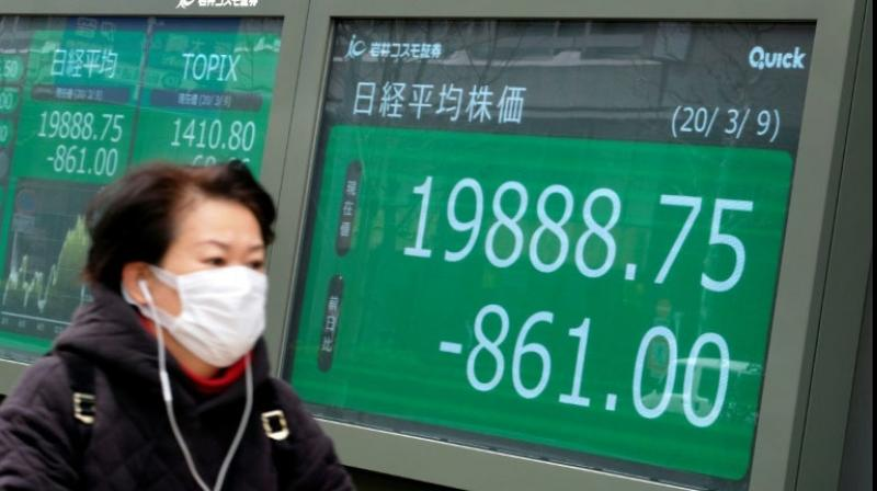 Asian shares skidded on Tuesday on growing worries about a second wave of coronavirus infections. (PTI Photo)