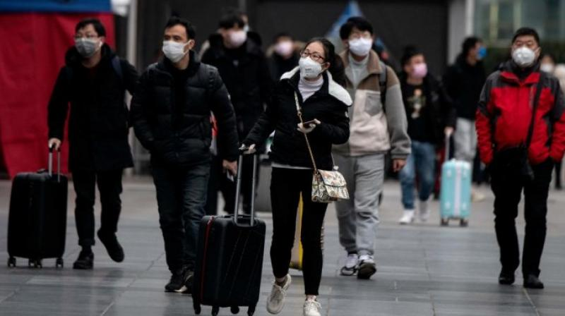 China says it is not yet the time to relax coronavirus measures. (AFP Photo)
