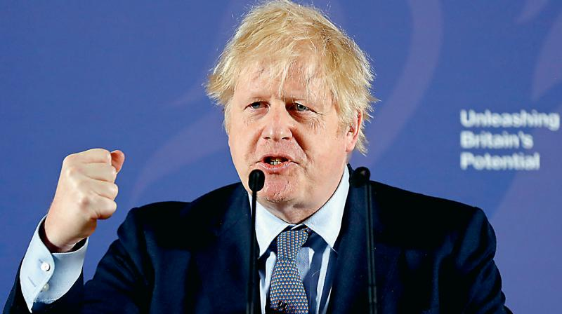 British Prime Minister Boris Johnson has warned that a mass vaccine for the novel coronavirus may be over a year away. (AP Photo)