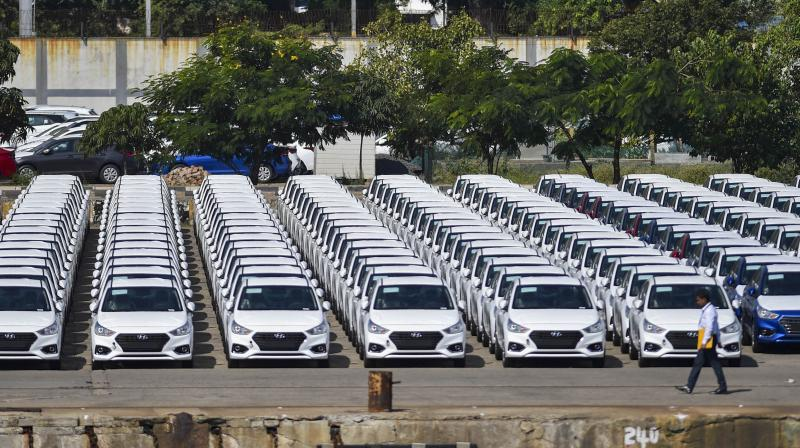 Some auto companies resume production after profit slumps on weak demand. (PTI Photo)