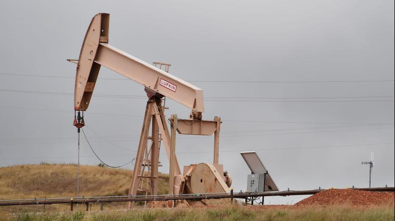 Oil prices crept up on Thursday, supported by a surprise decline of U.S. crude inventories. (AFP Photo)