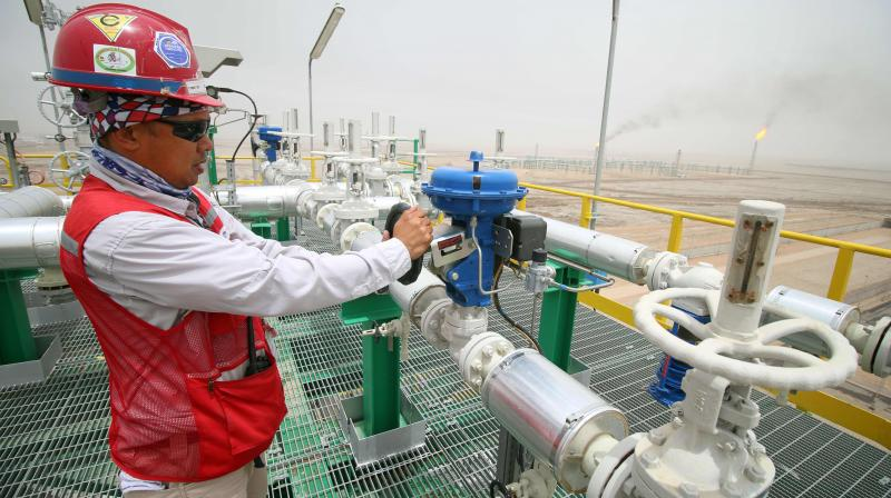Oil prices ease on dim economic outlook despite signs of firmer demand. (AFP Photo)