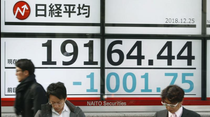 Hong Kong stocks tumble, Asian shares lower as Beijing impose new security law. (AP Photo)