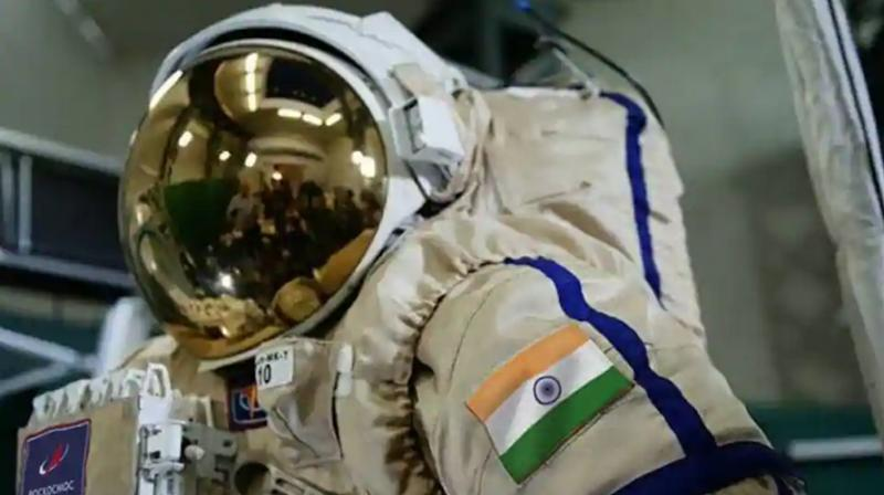Roscosmos tweeted a picture of the cosmonauts wearing space suit bearing Indian flag.(Photo- Roscosmos twitter)