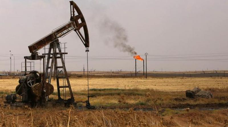 Oil climbs as suppliers stick to output cuts, coronavirus lockdowns ease. (AFP Photo)