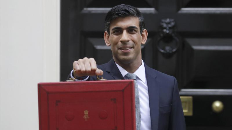 UK's covid19 job saving scheme to taper off from August, says Rishi Sunak. (AP Photo)