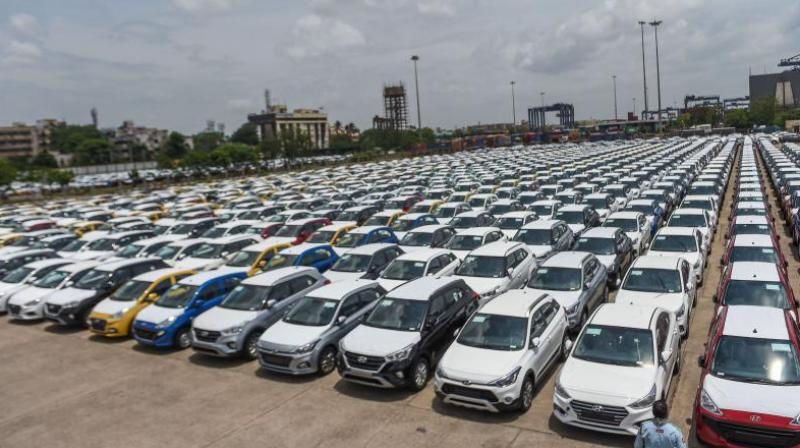 Auto dealers seek higher sales margin, cost reduction measures amid Covid19 crisis. (AFP Photo)