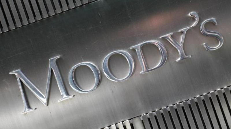 Moody's cuts India's rating to lowest investment grade with negative outlook. (PTI/AFP Photo)