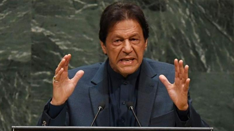 Pakistan prime minister Imran Khan defends lifting lockdown, urges nation to 'live with the virus'. (AFP Photo)