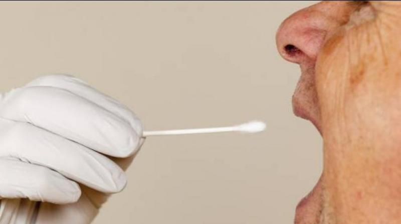 Japan allows saliva-based tests to boost coronavirus detection. (AFP Photo)