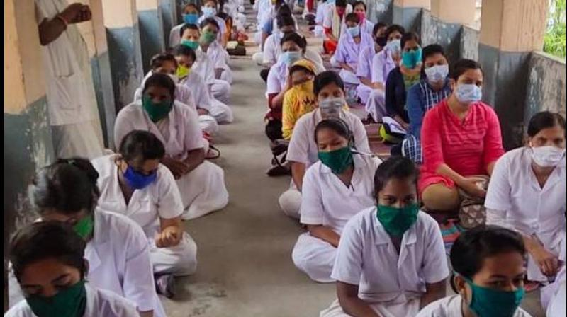 Nurses at Mumbai's civic-run KEM Hospital protested demanding a separate ward for colleagues infected by the Covid-19. (PTI Photo)