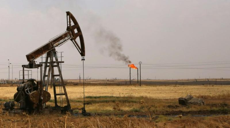 Oil hits three-month high over hopes for output cuts. (AFP Photo)