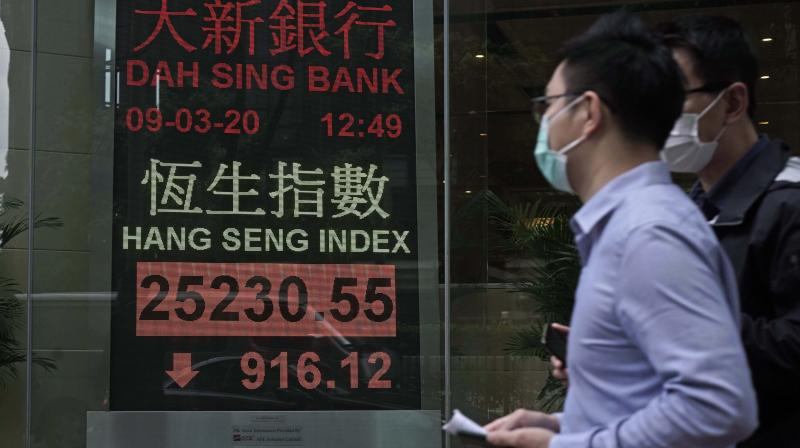 Asian shares hit two-month high as economic optimism spreads. (AFP Photo)